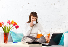 Portrait of a young woman working at home Stock Photography