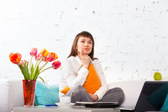 Portrait of a young woman working at home Stock Image