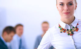 Portrait of a young woman working at office standing Royalty Free Stock Images