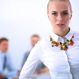 Portrait of a young woman working at office standing Royalty Free Stock Photo