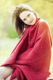 Portrait of young woman wrapped in blanket outdoors Royalty Free Stock Photography