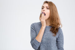 Portrait of a young woman yawning Stock Photography