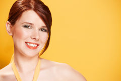 Portrait of young woman on yellow background stock photography