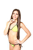 Portrait of young woman in a yellow bathing suit on a white back Royalty Free Stock Image