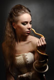 Woman and snake Stock Photography