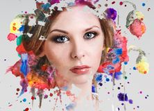 Portrait of young woman and colorful paint blots. Portrait of young women and colorful paint blots. Over gray background royalty free stock photography