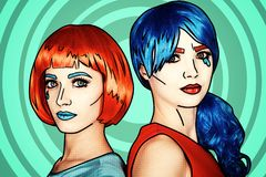 Portrait of young women in comic pop art make-up style. Females in red and blue wigs royalty free stock photos