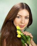 Portrait of young women with flowers Stock Photo