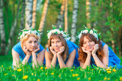 Portrait of young women having a rest on a lawn Royalty Free Stock Photos