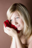 Portrait of young women holding petals Royalty Free Stock Images