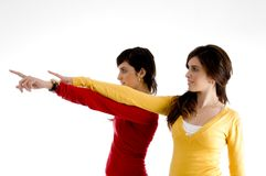 Portrait of young women pointing aside Royalty Free Stock Photos