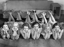 Portrait of young women in row on floor Stock Photography