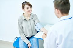 Young Woman Visiting Doctor royalty free stock photo