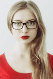 Portrait of young wooman with black glasses Royalty Free Stock Photography