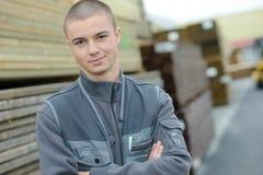 Portrait young worker in builders merchants Stock Photo