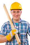 Portrait of young  worker holding wooden planks on shoulder isol Stock Image