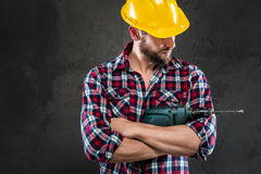 Portrait of young workman with drill Royalty Free Stock Images