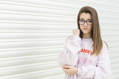 Portrait of a young 15 year old teenager. With glasses on a metallic background. Horizontal shot Stock Photos