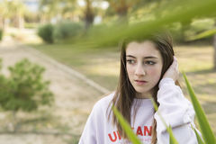 Portrait of a young 15 year old teenager. Between the plants of a park Stock Photos