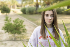 Portrait of a young 15 year old teenager. Between the plants of a park Stock Photography