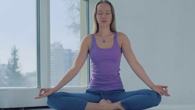 Portrait of young yoga woman meditating after practicing yoga stock video