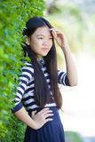 Portrait of younger asian teen with happiness emotion and smilin Royalty Free Stock Photo