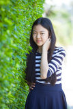 Portrait of younger asian teen with happiness emotion and smilin Stock Photos