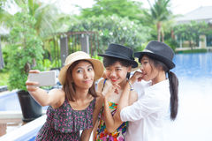 Portrait of younger asian woman selfie by smart phone use for mo stock photos