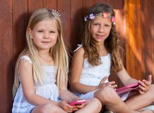Portrait of youngsters with tablet and smart phone. Royalty Free Stock Photos