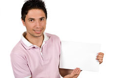 Portrait of youth male presenting a blank page. Youth male presenting a blank page and looking at you isolated on white background,check also People with blank Royalty Free Stock Images