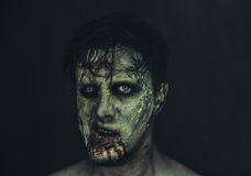 Portrait of zombie man. Portrait of scary zombie man on dark background, Halloween makeup stock image