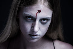 Portrait of zombie with wound on forehead Stock Image
