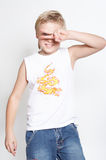 Portrait2 of the eleven-year boy. Glory. Portrait of a boy of eleven years. The boy is dressed in jeans and a white T-short. A background is white Royalty Free Stock Image
