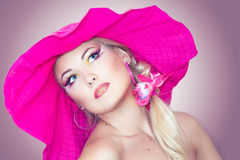 Portraite of a blonde girl with a hat Royalty Free Stock Image