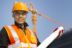 Portraite site manager with safety vest. Under construction stock images