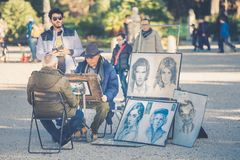 Portraitist street. Designer faces Royalty Free Stock Image