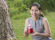 Portraits Asian Woman with a pitcher in hand. stock photo