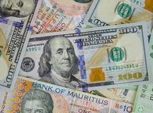 Portraits on banknotes. Close up. US dollars and Mauritius bills Stock Photos