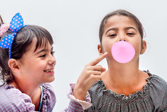 Portraits of beautiful little girls blowing bubbles Royalty Free Stock Image