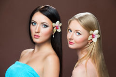 Portraits of beautiful white caucasian women. With flower orchid Royalty Free Stock Photo