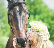 Portraits of beautiful women with her mare Stock Photo