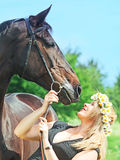 Portraits of beautiful women with her mare Royalty Free Stock Photography