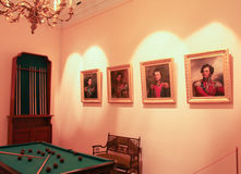 Portraits in the billiard room. Stock Images