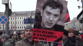 Portraits of Boris Nemtsov on the March opposition stock video