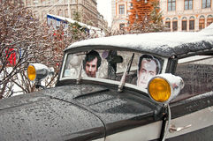 Portraits of characters in the movie Conan Doyle in a retro car. On the birthday of Sherlock Holmes in the streets January 4, 2015 Riga, Latvia Stock Photography