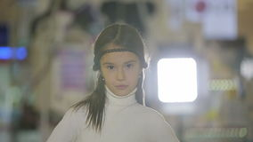 Portraits of children at shop, female child doing facial expressions and smiling stock video