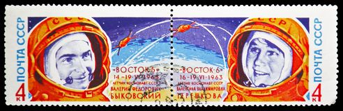 Portraits of cosmonaut V.V. Tereshkova and V.F. Bykovsky and rocket, Second Group Spaceflight serie, circa 1963. MOSCOW, RUSSIA - MAY 25, 2019: Two postage royalty free stock image