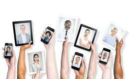 Portraits of Diverse People On Digital Devices Royalty Free Stock Photos