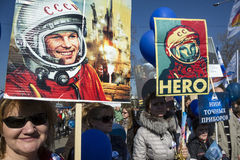Portraits of the firt cosmonaut Yuri Gagarin. Russia, Moscow, 12 of April 2015:Participants in the Star Parade hold portraits of the firt cosmonaut Yuri Gagarin Royalty Free Stock Image