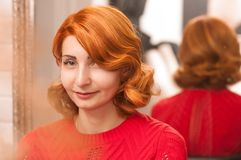Portraits of a girl with red hair and hair golivwood wave stock image